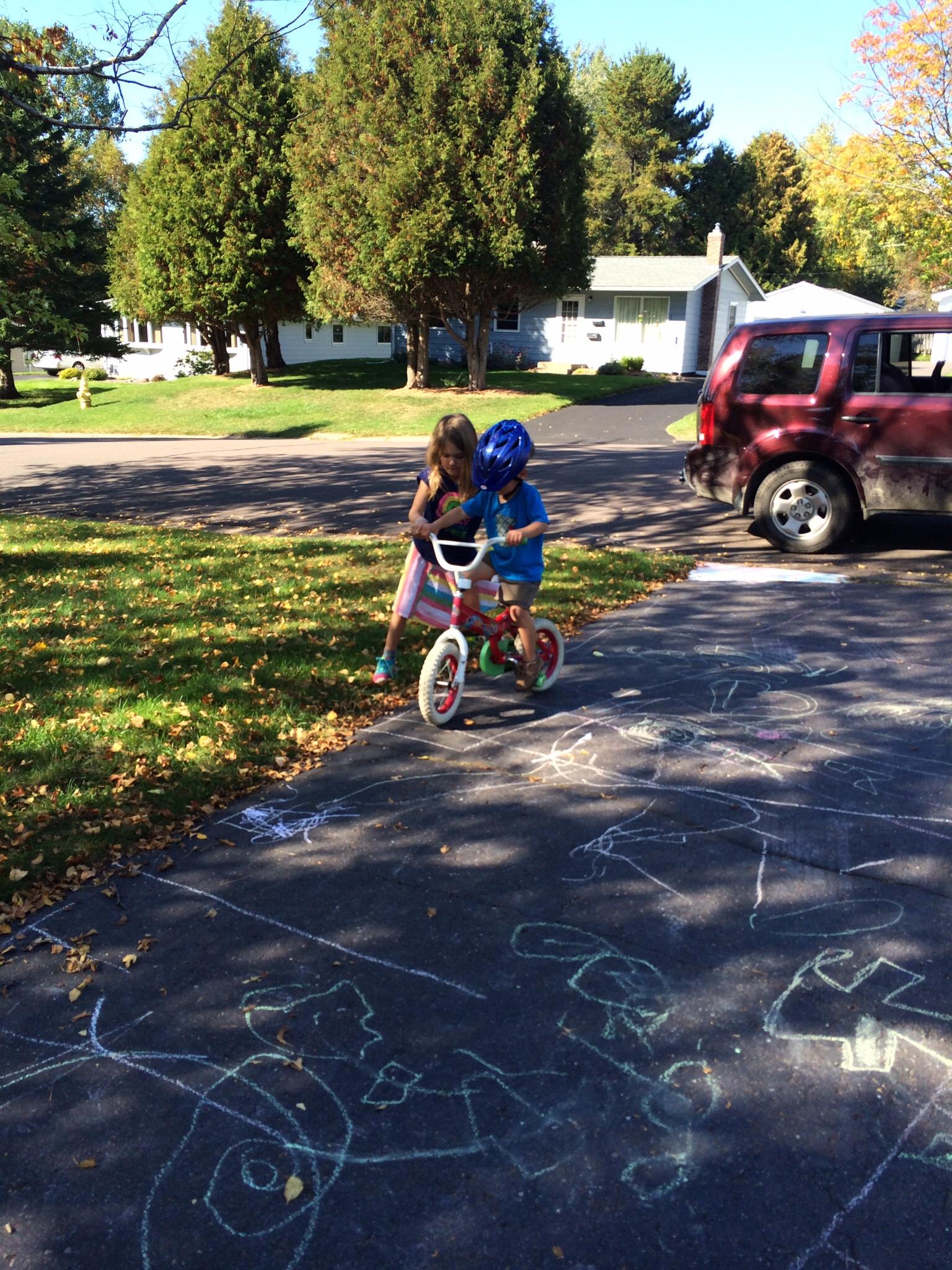 """Calista """"teaching"""" XS to ride a 2-wheeler"""