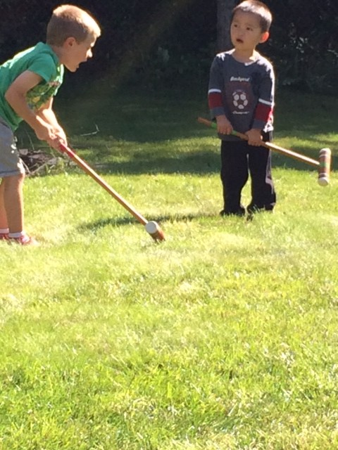 they take turns like lumberjacks.  too be fair, Calista started this game but the boys LOVE it!