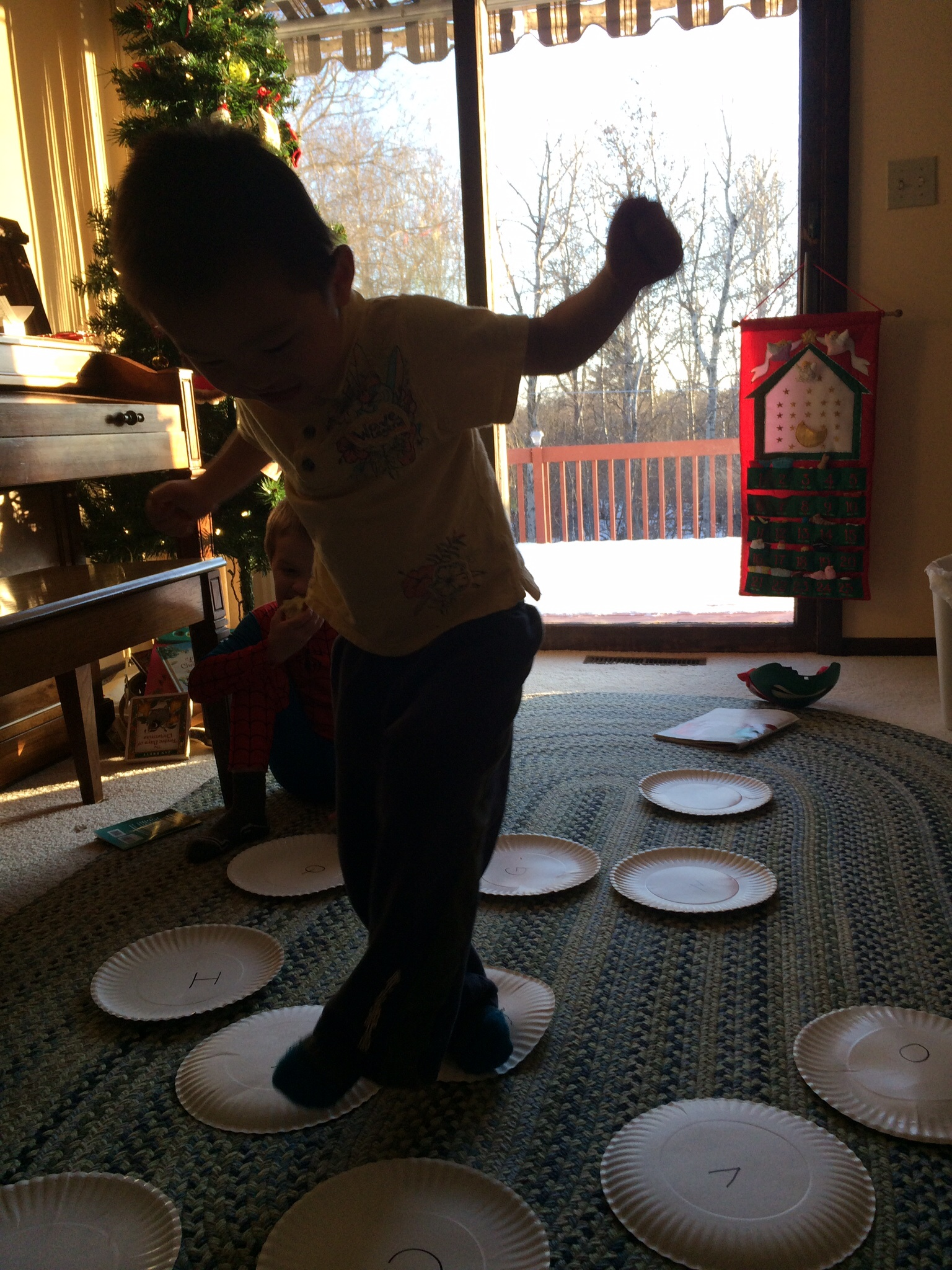 We write the Chinese characters on plates and make up all sorts of games.  We also have the alphabet on plates.  Calista has to spell, Elam has to make the sound and XS has to find the letter: 3 for 1 educational CHEAP game.