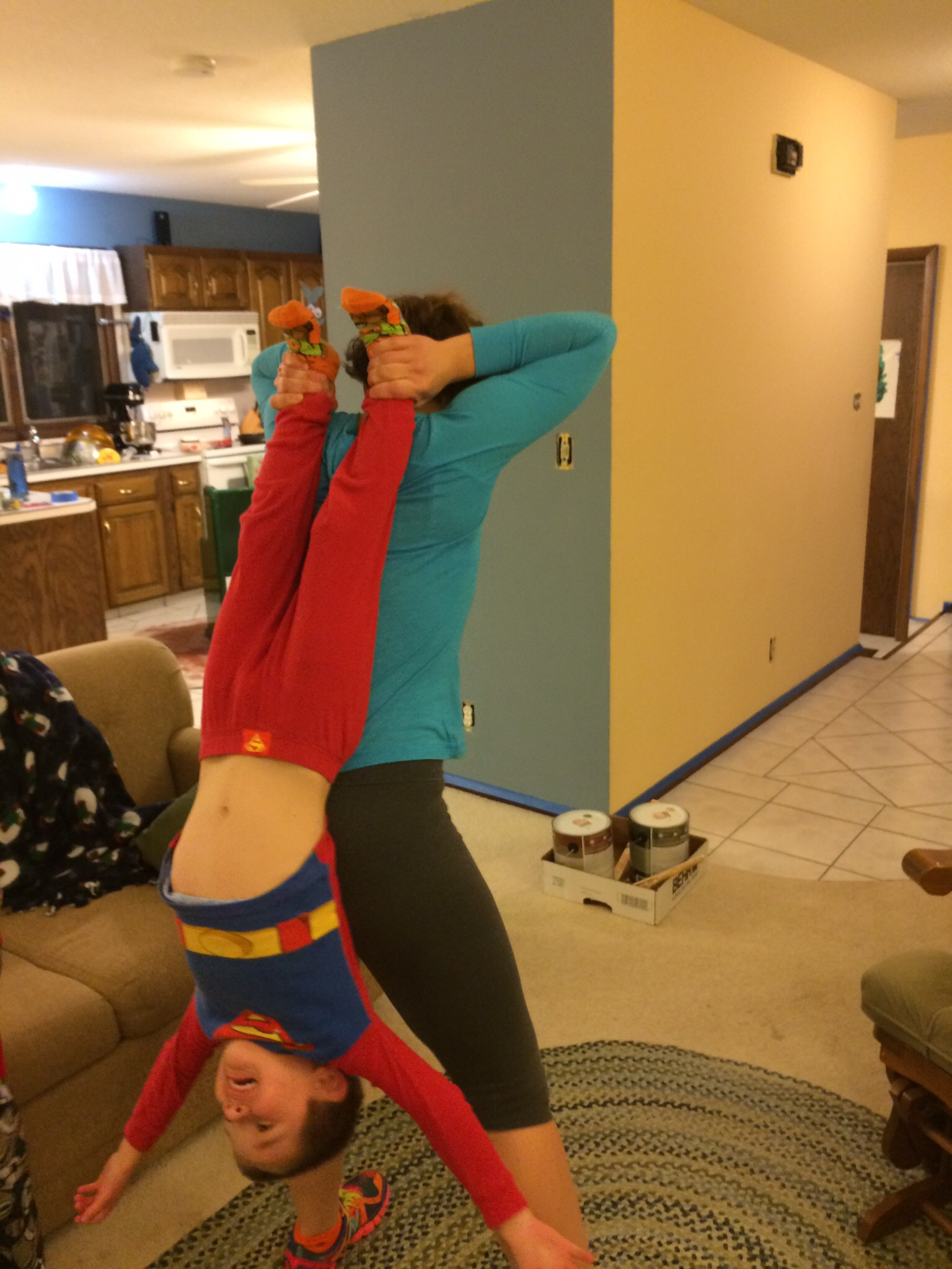 Brian and I were lifting the boys like this the other night to work on our triceps.  Bonding with the kids and a sweat: WIN WIN!